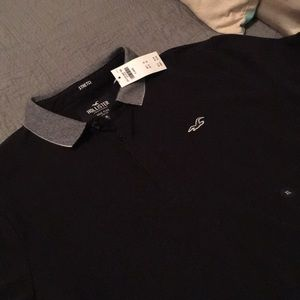 Flex black polo with pattern on collar and sleeve
